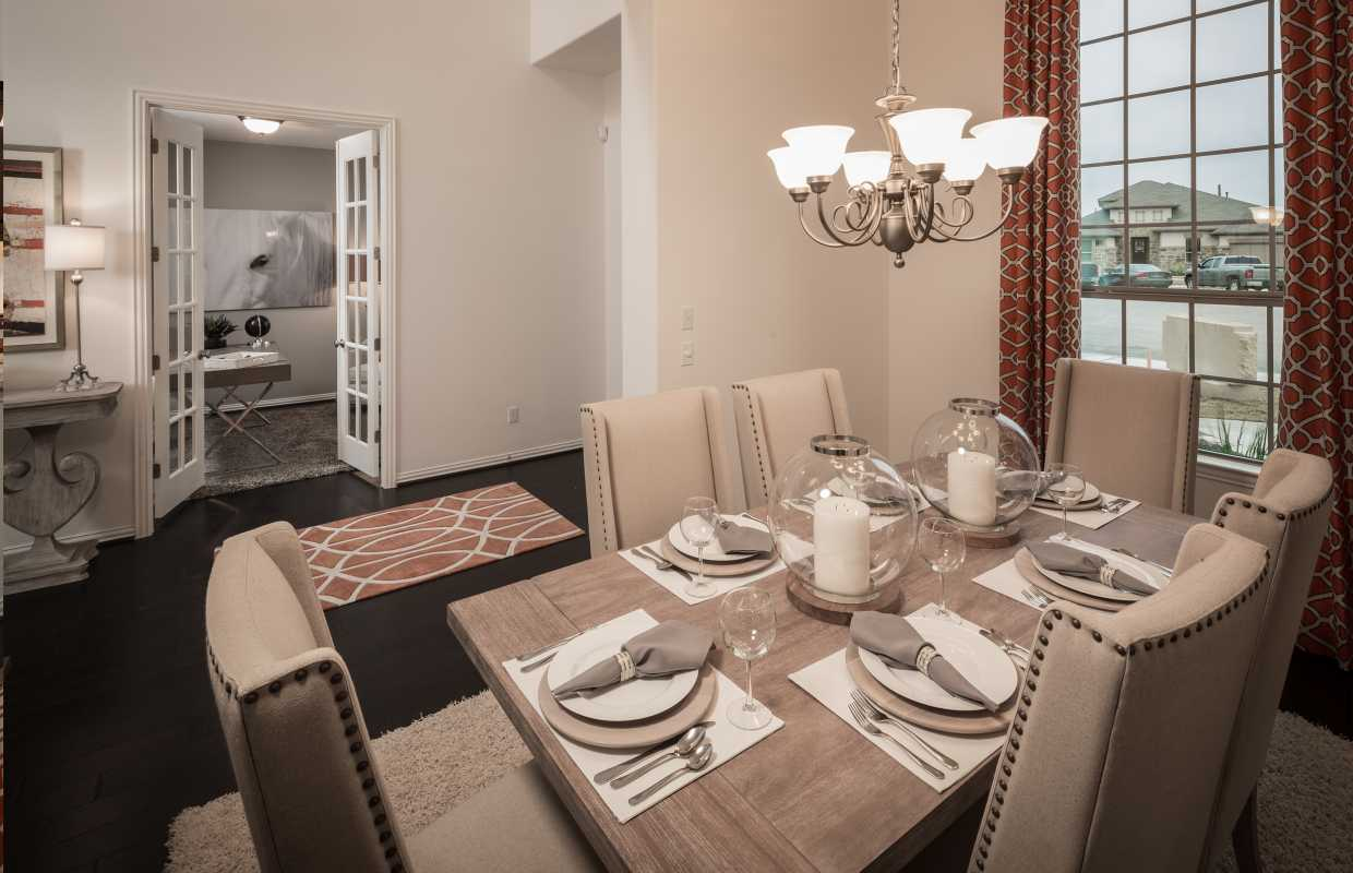Model home in austin texas santa rita ranch north community for Model home dining room